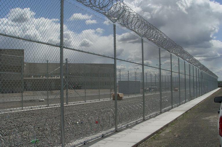 Chain Link with Barbed Wire