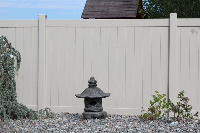 White Vinyl Fencing and Shrine